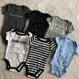6 pc Calvin Klein baby bodysuit bundle